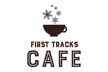 First tracks cafe logo, a coffee cup with snowflakes